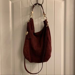 Michael Kors burgundy suede bag.